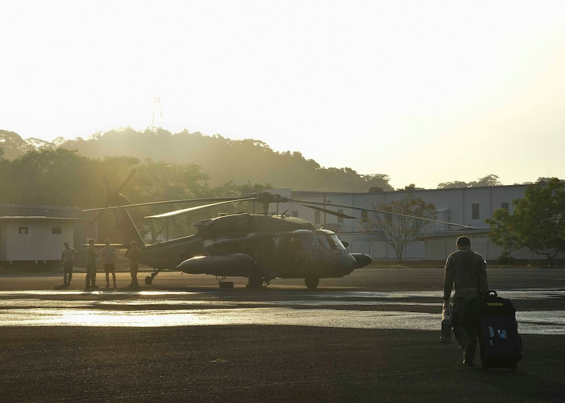 Members of the 1st Battalion, 228th Aviation Regiment, Soto Cano Air Base, Honduras, prepare a UH-60 Black Hawk helicopter for flight in the Arraiján District of Panama, April 17, 2016. The 1-228th AVN was in Panama to support Panamanian Public Forces firefighting operations in the Darién Province, where wildfires had been burning since April 4. (U.S. Air Force photo by Staff Sgt. Siuta B. Ika)