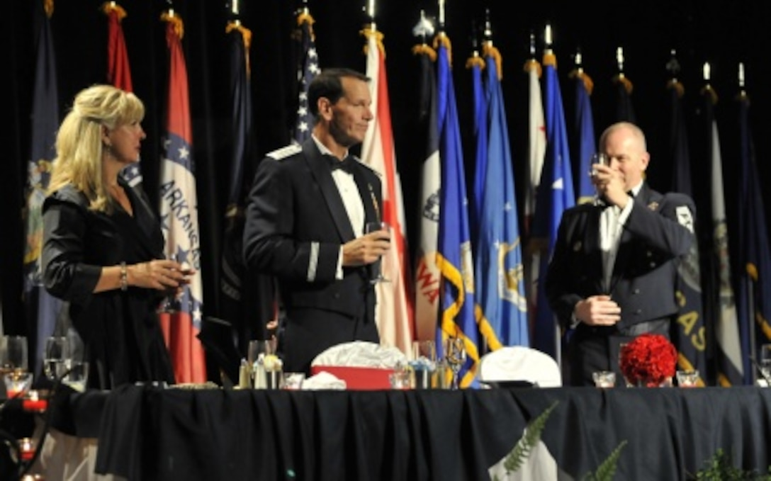 Chief Master Sgt. James W. Hotaling, the command chief master sergeant of the Air National Guard, toasts Lt. Gen. Stanley E. Clarke III, director of the Air National Guard, during his Order of the Sword induction ceremony at the Renaissance Hotel in Montgomery, Ala., April 17, 2016. Clarke is the 13th Air National Guard officer to be inducted into the Order of the Sword, which is the top honor the enlisted corps can bestow upon an officer. (U.S. Air National Guard photo by Tech. Sgt. William Buchanan/Released)