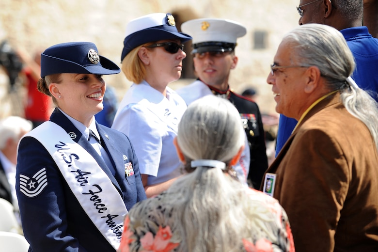 Tech. Sgt. Jacqueline Crow, an intelligence analyst with the 149th Fighter Wing, Texas Air National Guard, headquartered at Joint Base San Antonio-Lackland, Texas, visits with community members during an annual San memorial service, March 6, 2016, honoring those killed in the 1836 Battle of the Alamo. Crow represents JBSA as an Air Force ambassador, which is part of a community engagement program. (U.S. Air National Guard photo by Tech. Sgt. Rebekkah Jandron)