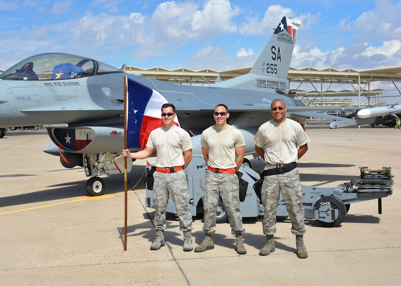 Senior Airman Robert Satter (left), Tech. Sgt. Federico Barrios (center) and Tech. Sgt. Mark Nash (right), aircraft armament systems technicians assigned to the 149th Fighter Wing, Texas Air National Guard, stand in a group following to the loading portion of the 56th Fighter Wing's quarterly load crew of the quarter competition at Luke Air Force Base, Arizona, April 8, 2016. The competition is a quarterly event that recognizes the top aircraft armament systems technicians operating at Luke. 149th Fighter Wing, headquartered at Joint Base San Antonio-Lackland, Texas, is currently operating at Luke while San Antonio's Kelly Field undergoes runway repairs. (U.S. Air National Guard photo by 2nd Lt. Phil Fountain)