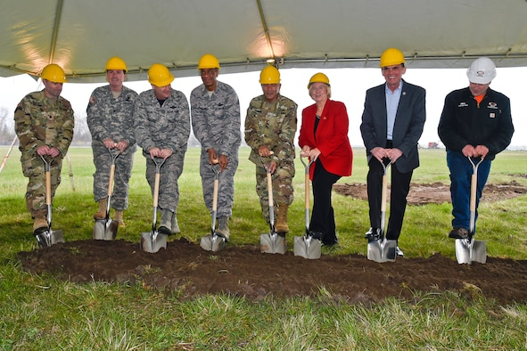 Ground is broken April 22, 2016, at Selfridge Air National Guard Base, Mich., on a new jet fuel storage and delivery system. Digging out the ceremonial first shovel of direct are: Lt. Col. Michael Sellers, commander of the Detroit District, U.S. Army Corps of Engineers; Col. Stephen Ward, U.S. Property & Finance Officer, Michigan National Guard; Brig. Gen. John. D. Slocum, commander, 127th Wing; Brig. Gen. Leonard W. Isabelle, Jr., commander, Michigan Air National Guard; Major Gen. Gregory J. Vadnais, adjutant general of Michigan; U.S. Rep. Candice Miller, R-Mich.; Mark Hackel, Macomb County Executive; Mike Long, superintendent of Garco Construction. (U.S. Air National Guard photo by Terry Atwell)