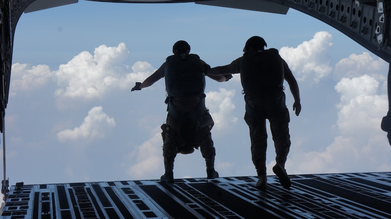 Pararescue jumpers with the 31st Rescue Squadron conduct a High Altitude Low Opening jump out of a a C-17 Globemaster III aircraft crewed by airmen from the 535th and 204th Airlift squadron during Balikatan 2016, Clark Air Field, Philippines, April 15, 2016. Balikatan, which means shoulder to shoulder in Filipino, is an annual bilateral training exercise aimed at improving the ability of Philippine and U.S. military forces to work together during planning, contingency and humanitarian assistance and disaster relief operations. (U.S. Air National Guard photo by Tech. Sgt. Andrew Jackson/released)