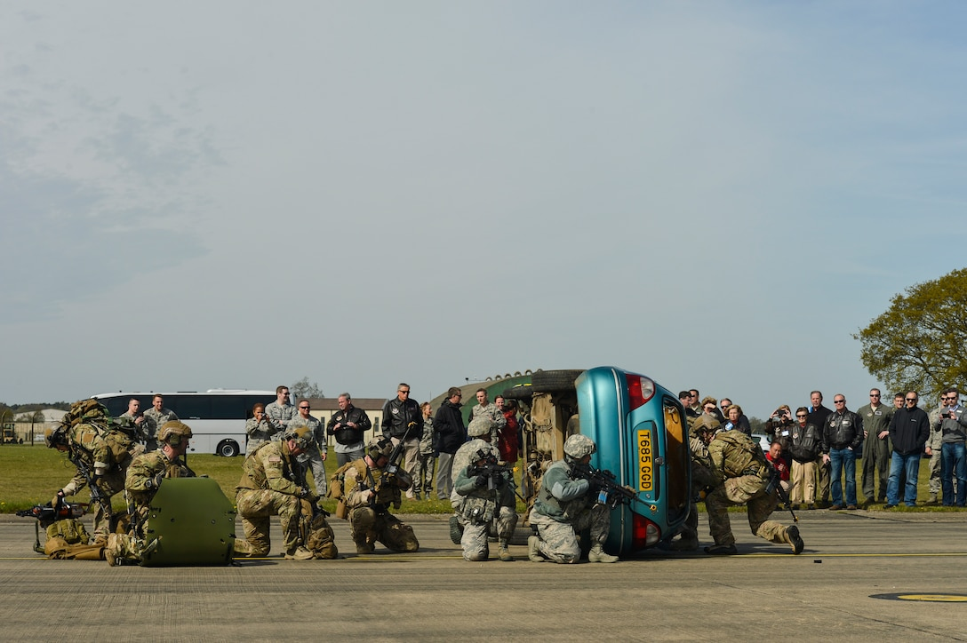 A group of U.S. Air Force pararescuemen with the 57th Rescue Squadron and 48th Security Forces Airmen conduct a combat search and rescue demonstration at Royal Air Force Lakenheath, England, for a group of Air Force civic leaders who act as key communicators and advocates for the Air Force, April 21, 2016. Pararescuemen performed various CSAR maneuvers to showcase their capabilities during a Chief of Staff of the  Air Force Civic Leader visit. (U.S. Air Force Photo by Tech. Sgt. Joshua DeMotts)