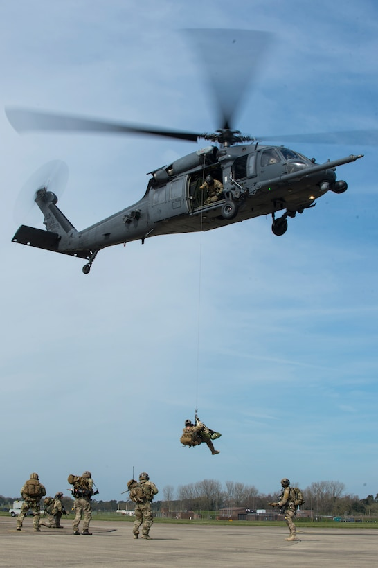 A pararescueman assigned to the 57th Rescue Squadron is hoisted into an HH-60G Pave Hawk during a combat search and rescue demonstration at Royal Air Force Lakenheath, England, April 21, 2016. Pararescuemen performed various CSAR maneuvers in response to a simulated threat and hostile environment scenario. (U.S. Air Force photo/Staff Sgt. Emerson Nuñez)