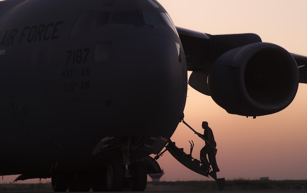 An Air Force crew chief boards the C-17 Globemaster III that will transport Marine Corps Gen. Joe Dunford, chairman of the Joint Chiefs of Staff, on his departure from Irbil, Iraq, April 22, 2016. Dunford visited Iraq to assess the campaign against the Islamic State of Iraq and the Levant. DoD photo by Navy Petty Officer 2nd Class Dominique A. Pineiro