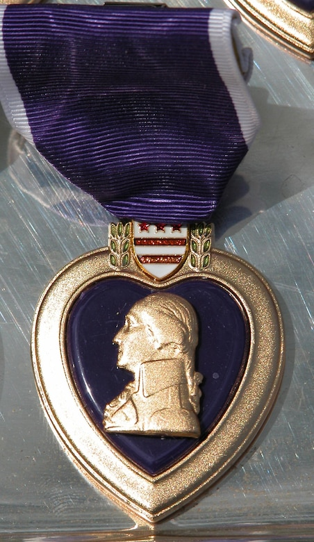George Washington, commander of the Continental Army during the Revolutionary War and the first president of the United States, originated the Purple Heart Medal. After the American colonists had won their freedom from England, the medal was discontinued until it was revived in 1932. During his trip to Iraq on April 22, 2016, Marine Corps Gen, Joe Dunford, the chairman of the Joint Chiefs of Staff, awarded Purple Heart medals to four Marines wounded during the Islamic State of Iraq and the Levant attack on Fire Base Bell in March. DoD photo by Gerry J. Gilmore