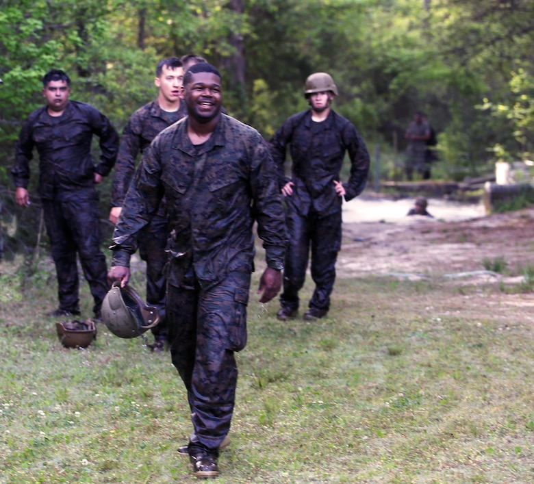 A group of Marines with Combat Logistics Regiment 2 completes an endurance course at Camp Lejeune, N.C., April 22, 2016. The unit pushed through the grueling 3.4 mile course to improve their ability to work as a team and to build camaraderie.
