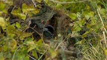 Lance Cpl. Thomas Hunt, a designated marksman with 1st Platoon, Bravo Company, 2nd Law Enforcement Battalion, looks through the scope of his M110 sniper rifle while concealed in the tree line during the II Marine Expeditionary Force Command Post Exercise 3 at Marine Corps Base Camp Lejeune, North Carolina, April 20, 2016. During the CPX, 2nd LEB posted security around the campsite and defended it from mock enemies, ensuring the headquarters element could complete the mission safely.