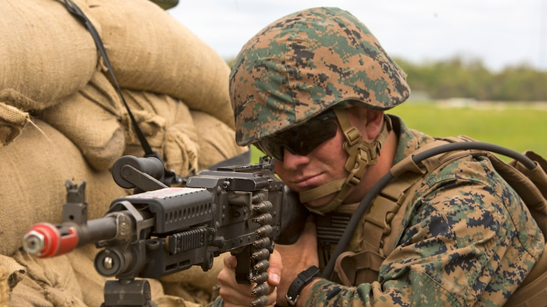 Pfc. Garrett Cone, a rifleman with 1st Platoon, Bravo Company, 2nd Law Enforcement Battalion, sights-in with the scope of his M240B machine gun while manning a security post during the II Marine Expeditionary Force Command Post Exercise 3 at Marine Corps Base Camp Lejeune, North Carolina, April 20, 2016. During the CPX, 2nd LEB posted security around the campsite and defended it from mock enemies, ensuring the headquarters element could complete the mission safely.