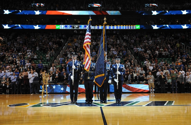 The Utah Air National Guard Honor Guard team presents the colors during the Utah Jazz game April 11, 2016, at the Vivint Smart Home Arena in Salt Lake City. The honor guard team has helped kick off 12 home games this season. (U.S. Air National Guard photo by Senior Airman Colton Elliott/Released)