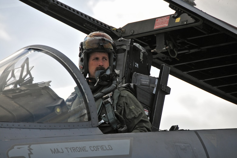 """U.S. Air Force and Massachusetts Air National Guard Lt. Col. David """"Moon"""" Halasi-Kun, 131st Expeditionary Fighter Squadron detachment commander, prepares for his mission in an F-15C Eagle, April 20, 2016.  The 131st EFS is participating in the Royal Netherlands Air Force Frisian Flag 2016 exercise, Leeuwarden Air Base, Netherlands.  The exercise runs from April 11-22 and is comprised of more than 70 aircraft and several hundred personnel from the United States, Netherlands, Belgium, France, Finland, Poland, Norway, United Kingdom, Germany and Australia. (U.S. Air National Guard photo by 1st Lt. Anthony Mutti /Released)"""