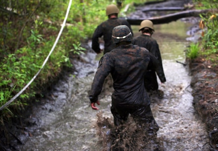Marines with Combat Logistics Regiment 2, make their way through an endurance course at Camp Lejeune, N.C., April 22, 2016. The unit pushed through the grueling 3.4 mile course to improve their ability to work as a team and to build camaraderie.
