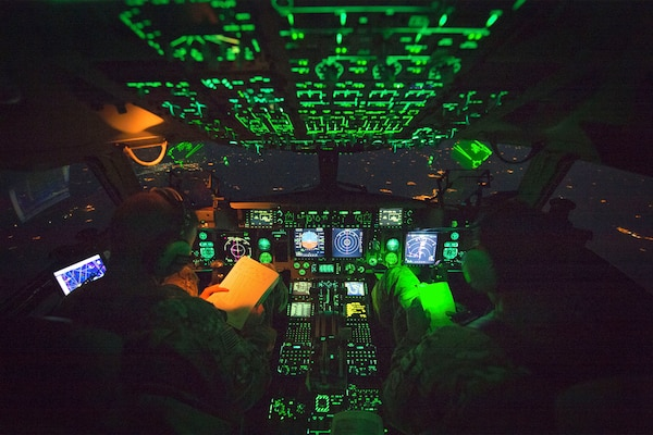 Air Force Capt. Mike Elliott, aircraft commander, and Air Force Capt. Addison Schenk,co-pilot, fly a C-17 after Marine Gen. Joseph F. Dunford Jr., chairman of the Joint Chiefs of Staff, departed Iraqi Kurdistan April 22nd, 2016. Dunford visited Iraq to assess the campaign against the Islamic State of Iraq and the Levant.(DoD Photo by Navy Petty Officer 2nd Class Dominique A. Pineiro)
