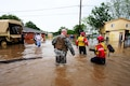 Soldiers and Texas Task Force 1 rescue personnel wade through deep water to help stranded residents during severe flooding in Wharton, Texas, April 21, 2016. The soldiers are assigned to the Texas Army National Guard's Company D, 536th Brigade Support Battalion. Texas Army National Guard photo by 1st Lt. Zachary West
