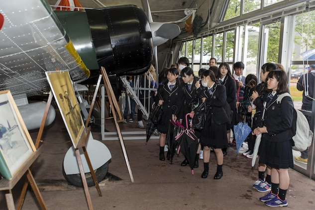 Students from Noda Gakuen High School in Yamaguchi City visit the Zero Hangar at Marine Corps Air Station Iwakuni, Japan, April 21, 2016. The Students traveled to MCAS Iwakuni as part of a interscholastic exchange with Matthew C. Perry High School. Events like these help secure the two nations' relationship with positive activities that educate both students about each other's culture. (U.S. Marine Corps photo by Lance Cpl. Aaron Henson/Released)