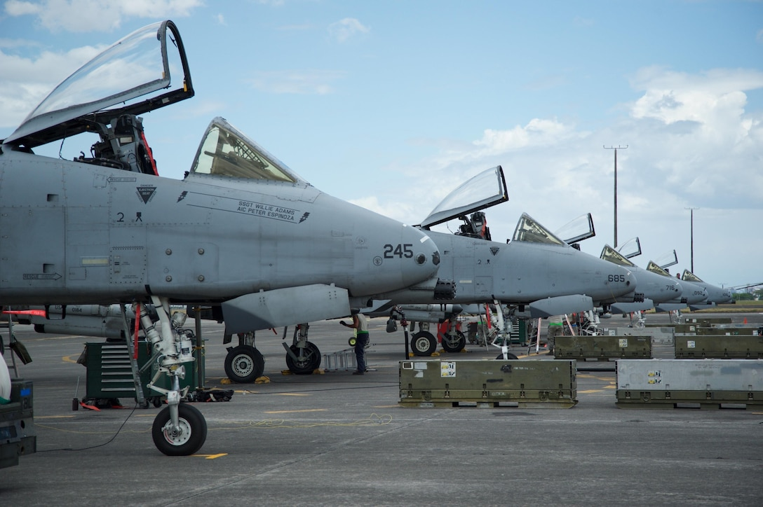 Five A-10C Thunderbolt IIs sit on the flight line at Clark Air Base, Philippines, after flying a training mission April 20, 2016. The aircraft are part of U.S. Pacific Command's first iteration of an Air Contingent at the base, which was stood up at the invitation of the Philippine government in order to strengthen cooperation and interoperability between the U.S. and Philippines. The Air Contingent provides forces capable of a variety of missions including force projection, air and maritime domain awareness, personnel recovery, combating piracy, assuring access to the air and maritime domains in accordance with international law and ensures safety and transparency of operations in international waters and airspace. (U.S. Air Force photo by Capt. Susan Harrington)