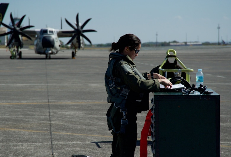 U.S. Air Force Capt. Stella Glojek reviews an A-10C Thunderbolt II aircraft maintenance record before taking off from Clark Air Base, Philippines, on a maritime domain awareness mission in the vicinity of Scarborough Shoal April 21, 2016. These missions are designed to provide greater and more transparent air and maritime situational awareness to ensure safety for military and civilian activities in international waters and airspace. Additionally, the A-10 presence enhances the presence of U.S. military assets in the region upholding freedom of navigation and over flight. (U.S. Air Force photo by Capt. Susan Harrington)