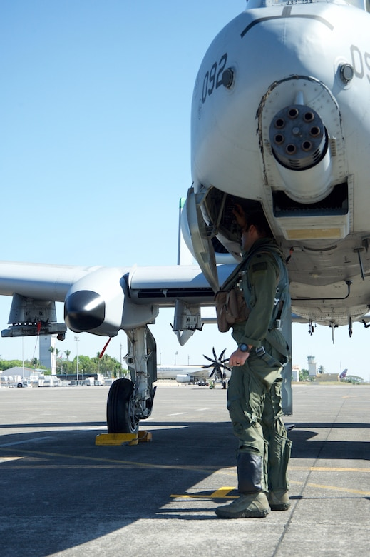 U.S. Air Force Capt. John Meyers conducts a pre-flight check on an A-10C Thunderbolt II aircraft at Clark Air Base, Philippines, before flying a maritime domain awareness mission over international waters west of the Philippines April 21, 2016. Meyers, along with five A-10Cs, three HH-60G Pave Hawks and 200 Airmen are deployed as part of U.S. Pacific Command's first Air Contingent. The stand up of the Air Contingent at the invitation of the Philippine government is just one way the U.S. exercises continued presence and commitment to partners and allies in the region. (U.S. Air Force photo by Capt. Susan Harrington)