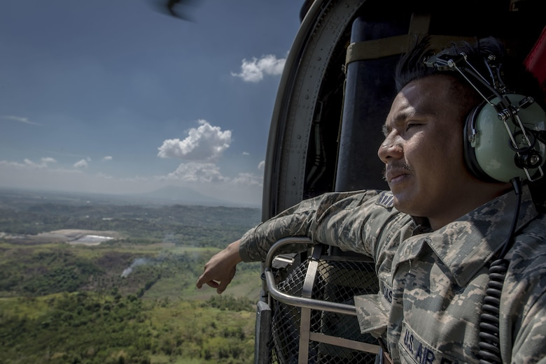 U.S. Air Force Staff Sgt. Jay Perocho Acasio, an aircrew flight equipment journeyman with the 51st Operations Support Squadron, Osan Air Base, Republic of Korea, looks out over his home country during a HH-60G Pave Hawk flight near Clark Air Base, Philippines, April 22, 2016. The staff sergeant is one of three Filipino-American Airmen serving U.S. Pacific Command's newly stood up Air Contingent in the Philippines. Acasio is from Ozamiz City in the Misamis Occidental, Philippines. (U.S. Air Force photo by Staff Sgt. Benjamin W. Stratton)