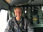 Erik Wetterhall, shown here aboard a UH-60M Blackhawk, is a customer logistics site specialist at Defense Logistics Agency Aviation at Huntsville, Alabama. Wetterhall was part of a support team traveling to Marietta Georgia April 6, 2016 to assist a Georgia National Guard unit with a fuel cell issue.