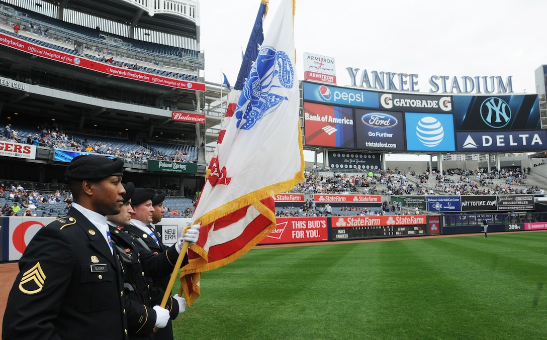 Staff Sgt. Adam Glover, Staff Sgt. Zachary Barrett, Staff Sgt. Harry Newman, and Staff Sgt. Luis Claudio with Headquarters and Headquarters Company, 3rd Brigade, 100th Division, from Ft. Totten in Queens provide the color guard on April 23, 2016, when the New York Yankees faced Tampa Bay Rays at Yankee Stadium. April 23rd marks the 108th anniversary of the United States Army Reserve. Army Reserve Soldiers are currently supporting all military branches and have been a vital part of our national military strategy during peacetime and war since it's founding in 1908. (U.S. Army Photo by Sgt. Nicole Paese)