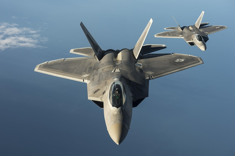 Two F-22 Raptors from the 95th Fighter Squadron at Tyndall Air Force Base, Fla., fly over the Baltic Sea on Sept. 4, 2015. Like the F-22 deployment last year, two F-22s deployed to Mihail Kogalniceanu Air Base, Romania. While in Europe, U.S. Air Force aircraft and Airmen will conduct air training with other Europe-based aircraft. (U.S. Air Force photo/Tech. Sgt. Jason Robertson)