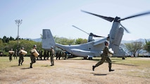 Japan Ground Self Defense Force personnel carry supplies from a U.S. Marine Corps MV-22B Osprey tiltrotor aircraft from Marine Medium Tiltrotor Squadron 265 (Reinforced), 31st Marine Expeditionary Unit, in Hakusui Sports Park, Kyushu island, Japan, April 22, 2016. The supplies are in support of the relief effort after a series of earthquakes struck the island of Kyushu. The 31st MEU is the only continually forward-deployed MEU and remains the Marine Corps' force-in-readiness in the Asia-Pacific region.