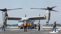 Japan Maritime Self Defense Force personnel finish refueling a U.S. Marine Corps MV-22B Osprey tiltrotor aircraft from Marine Medium Tiltrotor Squadron 265 (Reinforced), 31st Marine Expeditionary Unit, aboard the JS Hyuga, at sea, April 22, 2016. The Osprey received supplies from the Hyuga in support of the relief effort after a series of earthquakes struck the island of Kyushu. The 31st MEU is the only continually forward-deployed MEU and remains the Marine Corps' force-in-readiness in the Asia-Pacific region.