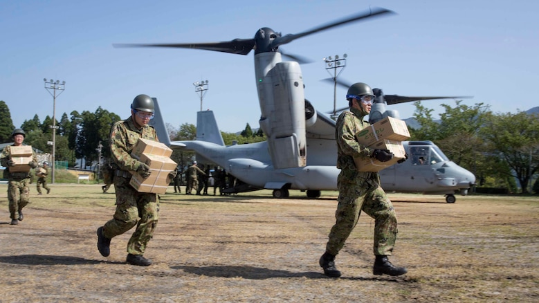 Japan Ground Self Defense Force personnel carry supplies from a U.S. Marine Corps MV-22B Osprey tiltrotor aircraft from Marine Medium Tiltrotor Squadron (VMM) 265 (Reinforced), 31st Marine Expeditionary Unit (MEU), in Hakusui Sports Park, Kyushu island, Japan, April 22, 2016. The supplies are in support of the relief effort after a series of earthquakes struck the island of Kyushu. The 31st MEU is the only continually forward-deployed MEU and remains the Marine Corps' force-in-readiness in the Asia-Pacific region. (U.S. Marine Corps photo by Cpl. Darien J. Bjorndal, 31st Marine Expeditionary Unit/ Released)