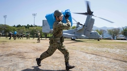 Japan Ground Self Defense Force personnel carry supplies from a U.S. Marine Corps MV-22B Osprey tiltrotor aircraft from Marine Medium Tiltrotor Squadron (VMM) 265 (Reinforced), 31st Marine Expeditionary Unit (MEU), in Hakusui Sports Park, Kyushu island, Japan, April 22, 2016. The supplies are in support of the relief effort after a series of earthquakes struck the island of Kyushu. The 31st MEU is the only continually forward-deployed MEU and remains the Marine Corps' force-in-readiness in the Asia-Pacific region.