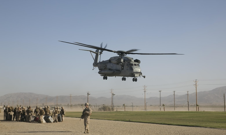 A CH-53 'Super Stallion' takes off from Del Valle Field aboard the Combat Center, as part of a Non-Combatant Evacuation Operation exercise in support of Weapons and Tactics Instructor Course 2-16 April 15, 2016. (Official Marine Corps photo by Cpl. Thomas Mudd/Released)