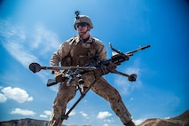 A U.S. Marine with the 13th Marine Expeditionary Unit, picks up his M-240 Bravo to maneuver to a new firing position during weapons familiarization training and drills on Range TC-02 during Western Pacific Deployment 16-1, Djibouti, Africa, April 17, 2016. The Marines are conducting weapons familiarization training and drills while in Djibouti to stay mission ready while in the SECOM area of operation.  (U.S. Marine Corps photo by Sgt. Hector de Jesus/RELEASED)
