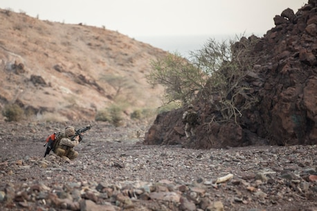 U.S. Marine Corporal Jordan Kane with the 13th Marine Expeditionary Unit fires at the enemy position on top of a ridge line during Tactical Recovery of Aircraft and Personnel training at Training Area Bravo 1, Djibouti, Africa, April 19, 2016. The 13th MEU is deployed in support of maritime security operations and theater cooperation efforts in the U.S. 5th fleet area of operations. (U.S. Marine Corps photo by Sgt. Hector de Jesus/RELEASED)