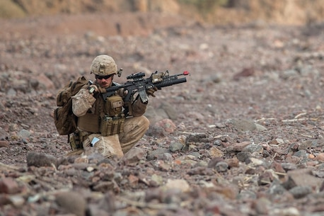 U.S. Marine Corporal Joshua Baker with the 13th Marine Expeditionary Unit sends and receives information over his radio during Tactical Recovery of Aircraft and Personnel training at Training Area Bravo 1, Djibouti, Africa, April 19, 2016. The 13th MEU is deployed in support of maritime security operations and theater cooperation efforts in the U.S. 5th fleet area of operations. (U.S. Marine Corps photo by Sgt. Hector de Jesus/RELEASED)