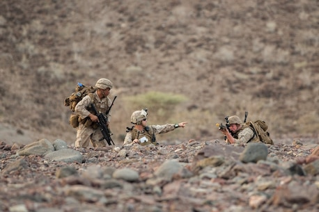 U.S. Marine Gunnery Sergeant Leonard Tardiff with the 13th Marine Expeditionary Unit directs Marines to new fighting positions during Tactical Recovery of Aircraft and Personnel training at Training Area Bravo 1, Djibouti, Africa, April 19, 2016. The 13th MEU is deployed in support of maritime security operations and theater cooperation efforts in the U.S. 5th fleet area of operations. (U.S. Marine Corps photo by Sgt. Hector de Jesus/RELEASED)