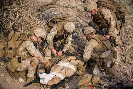 U.S. Marines and Sailors with the 13th Marine Expeditionary Unit prepare to transport a simulated injured isolated person to the extraction point during Tactical Recovery of Aircraft and Personnel training at Training Area Bravo 1, Djibouti, Africa, April 19, 2016. The 13th MEU is deployed in support of maritime security operations and theater cooperation efforts in the U.S. 5th fleet area of operations. (U.S. Marine Corps photo by Sgt. Hector de Jesus/RELEASED)