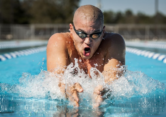 Senior Airman Francisco Perez Castillo, of the 96th Maintenance Group, comes up for air while swimming the breaststroke March 22, 2016, at Eglin Air Force Base, Fla. The 26-year-old Airman was recently inducted into the Pontifical Catholic University of Puerto Rico's sports hall of fame. (U.S. Air Force photo/Samuel King Jr.)