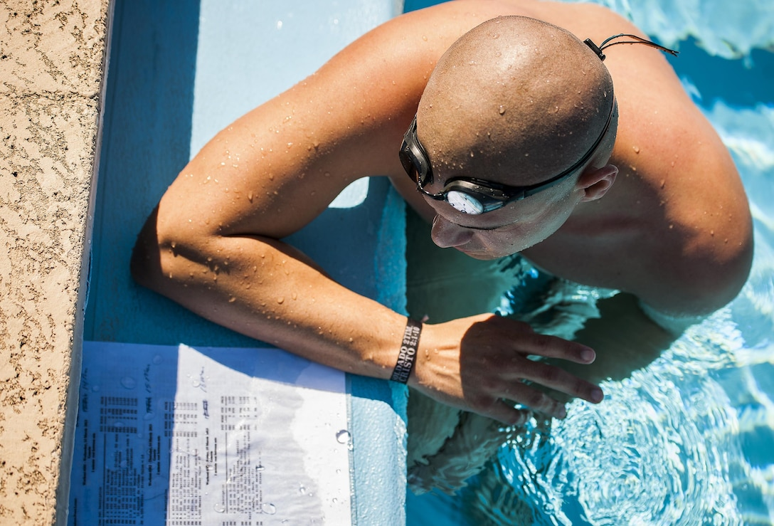 Senior Airman Francisco Perez Castillo, of the 96th Maintenance Group, studies his training regimen during a swim session March 22, 2016, at Eglin Air Force Base, Fla. The 26-year-old Airman was recently inducted into the Pontifical Catholic University of Puerto Rico's sports hall of fame. (U.S. Air Force photo/Samuel King Jr.)