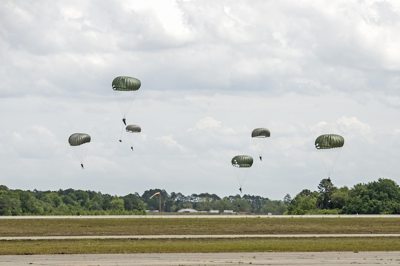U.S. Air Force Airmen from the 820th Base Defense Group descend onto the newly dedicated Lee D. Fulp Drop Zone, April 21, 2016, at Henry Tift Myers Airport, Tifton, Ga. Tech. Sgt. Lee Fulp served four tours in Afghanistan and Iraq. (U.S. Air Force photo by Airman 1st Class Janiqua P. Robinson/Released)