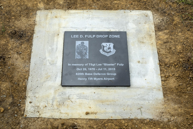 A plaque rests on the newly dedicated Lee D. Fulp Drop Zone, April 21, 2016, at Henry Tift Myers Airport, Tifton, Ga. Tech. Sgt. Lee Fulp served in the 820th Defense Group as an Explosive Ordnance Disposal NCO in charge. (U.S. Air Force photo by Airman 1st Class Janiqua P. Robinson/Released)