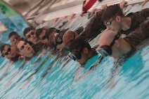 Sailors from Marine Forces Reserve and the U.S. Navy Reserve prepare to swim laps as part a water confidence exercise during a Fleet Marine Force reconnaissance corpsman screening in San Antonio, April 19, 2016. The screening was hosted by 4th Reconnaissance Battalion, 4th Marine Division, Marine Forces Reserve, for Reserve Sailors to gain familiarity with the demands of the FMF reconnaissance corpsman pipeline.