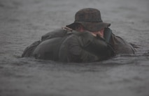 Petty Officer 3rd Class Josiah S. Gravelle, a hospital corpsman with Company E, 4th Reconnaissance Battalion, 4th Marine Division, Marine Forces Reserve finishes a 5000 meter fin swim during a Fleet Marine Force reconnaissance corpsman screening at Canyon Lake, Texas, April 21, 2016. The screening was hosted by 4th Reconnaissance Battalion for Reserve Sailors to gain familiarity with the demands of the FMF reconnaissance corpsman pipeline.