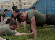 Petty Officer 2nd Class Thomas O. Dugan (right), a hospital corpsman with Headquarters and Service Company, 6th Engineer Support Battalion, 4th Marine Logistics Group, Marine Forces Reserve, completes the initial physical screening test for a Fleet Marine Force reconnaissance corpsman evaluation in San Antonio, April 19, 2016. The screening was hosted by 4th Reconnaissance Battalion, 4th Marine Division, Marine Forces Reserve, for Sailors across Marine Forces Reserve and the U.S. Navy Reserve to gain familiarity with the demands of the FMF reconnaissance corpsman pipeline.
