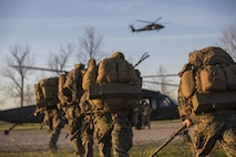 Scout Snipers with 2/24 Battalion, 23rd Marine Regiment, 4th Marine Division, Marine Forces Reserve, run to a Blackhawk Helicopter to practice insertion exercises during a fire support coordination exercise in Camp Atterbury, Ind., April 14, 2016. The Reserve Marines coordinated with worked with Company B, 8th Battalion, 229th Aviation Regiment (8-229 AV), 11th Aviation Command (Theater), a U.S. Army Blackhawk crew, and the U.S. Air Force to conduct combined arms training during the duration of the exercise.