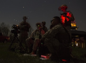 Reserve Marines with 2/24 Battalion, 23rd Marine Regiment, 4th Marine Division, Marine Forces Reserve, and 4th Air Naval Gunfire Liaison Company, Force Headquarters Group, MFR, call in fire support from pilots manning the A-10 Thunderbolt II, a low-altitude close air support aircraft, while conducting night operations during a fire support coordination exercise in Camp Atterbury, Ind., April 15, 2016. The Reserve Marines coordinated with both the U.S. Army and U.S. Air Force to conduct combined arms training during the exercise.