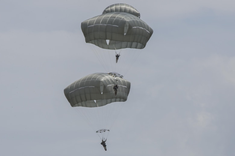 U.S. Air Force Airmen from the 820th Base Defense Group descend during a memorial jump ceremony, April 21, 2016, at Henry Tift Myers Airport, Tifton, Ga. The memorial was for Tech. Sgt. Lee Fulp. (U.S. Air Force photo by Airman Daniel Snider/Released)