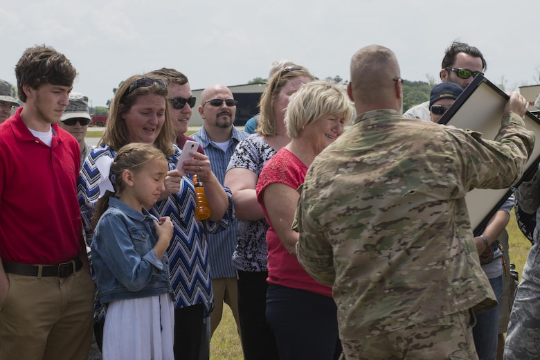 Family of U.S. Air Force Tech. Sgt. Lee Fulp receive a framed photo of the drop zone during a memorial jump ceremony, April 21, 2016, at Henry Tift Myers Airport, Tifton, Ga. The airport dedicated the drop zone to Fulp, who passed away in a motorcycle accident July 11, 2015. (U.S. Air Force photo by Airman Daniel Snider/Released)