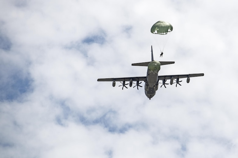U.S. Air Force Airmen from the 820th Base Defense Group jump out of an HC-130J Combat King II during a memorial jump ceremony, April 21, 2016, at Henry Tift Myers Airport, Tifton, Ga. More than 35 Airmen jumped to honor the memory of Tech. Sgt. Lee D. Fulp. (U.S. Air Force photo by Airman 1st Class Janiqua P. Robinson/Released)