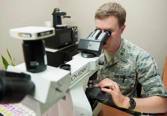 Maj. Michael McFall, a 96th Medical Group pathologist, looks through a microscope to study a patient's tissue April 21, 2016, at Eglin Air Force Base, Fla. Pathologists examine patient tissue to make the patient's diagnosis. (U.S. Air Force photo/Ilka Cole)