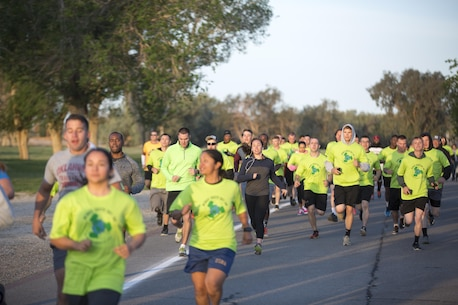 Combat Center patrons run through the Desert Winds Golf Course during the annual Earth Day 5K Fun Run April 15, 2016. The Combat Center strives to serve as a good steward of the environment and Natural Resources and Environmental Affairs held the run in observance of Earth Day. (Official Marine Corps photo by Cpl. Julio McGraw/Released)